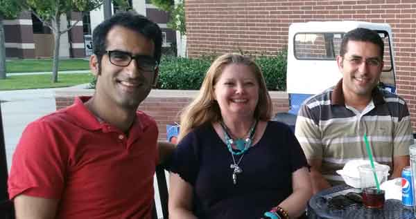 Amin and Ehsan with Mrs. C before class at the IVC Cafe